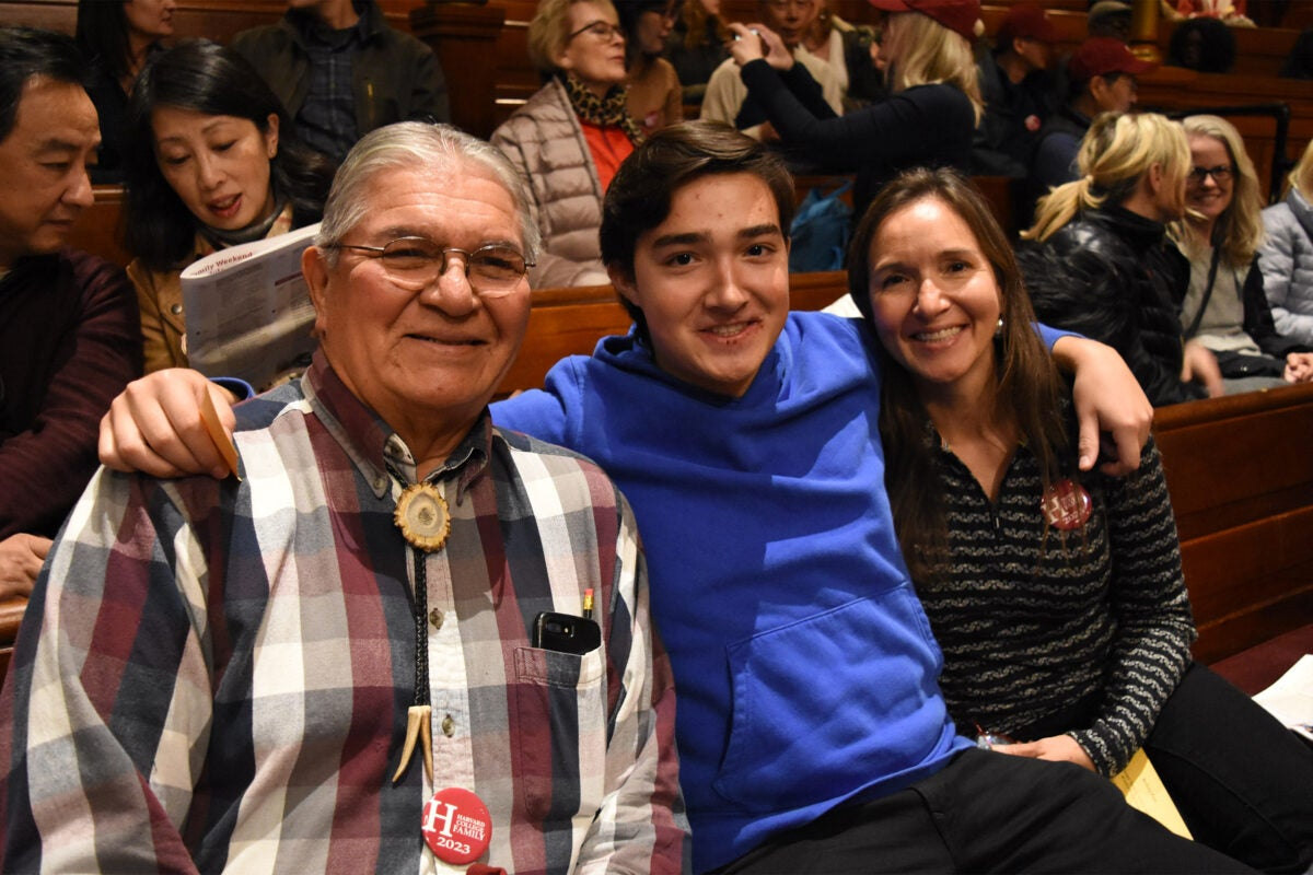 Student with grandfather and mother in Sanders Theatre.