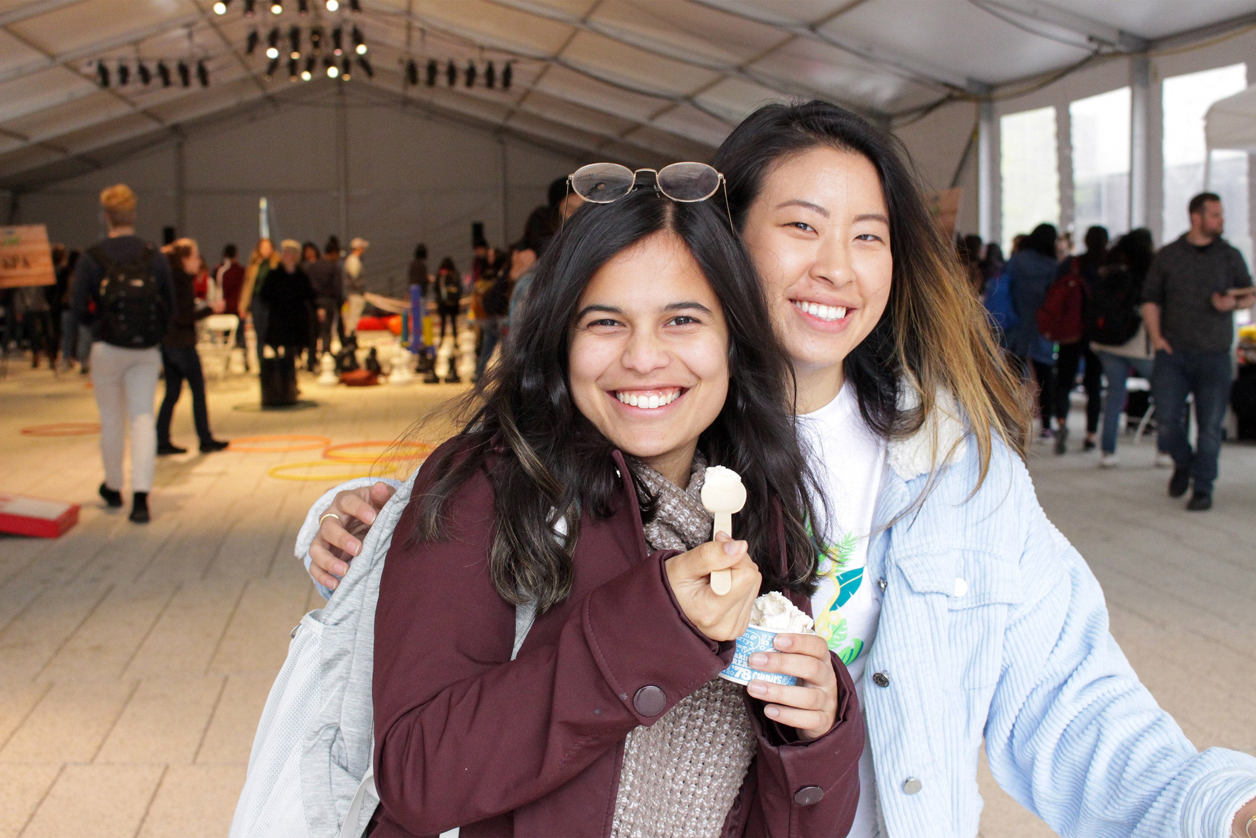 Two students at an ice cream social sponsored by CEB