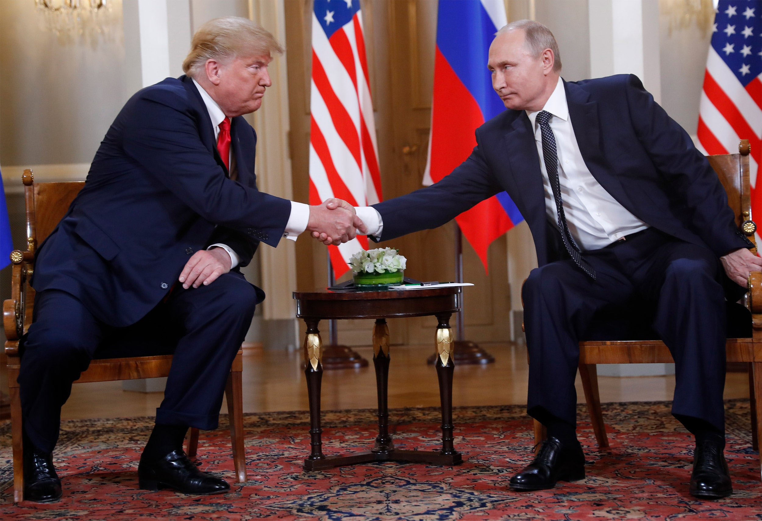 Trump and Putin shaking hands.