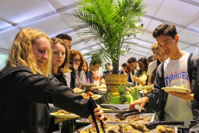 Taste of the Islands food bar with students lining yo