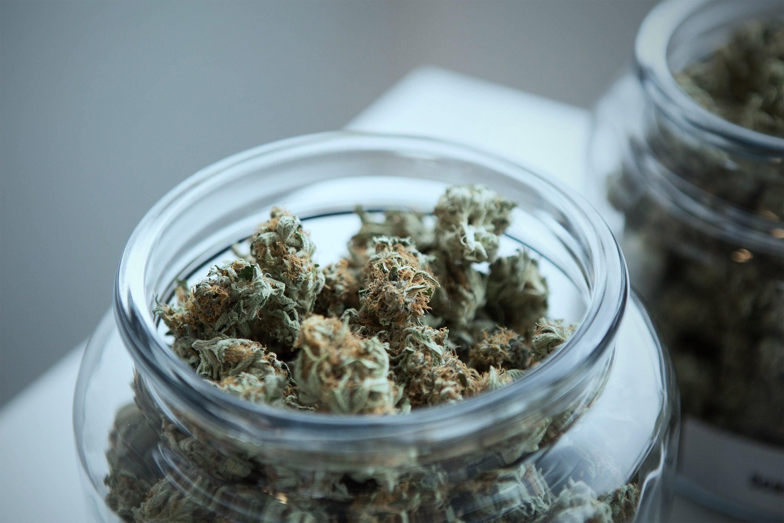 A jar with marijuana in it.