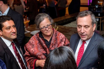 Victor Moscoso, Alice Hill, and Larry Bacow chat with conference-goers