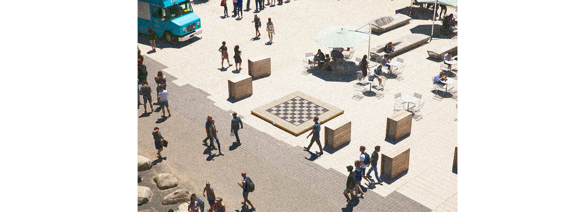Overview of tables, food truck, passers-by in Science Center Plaza.