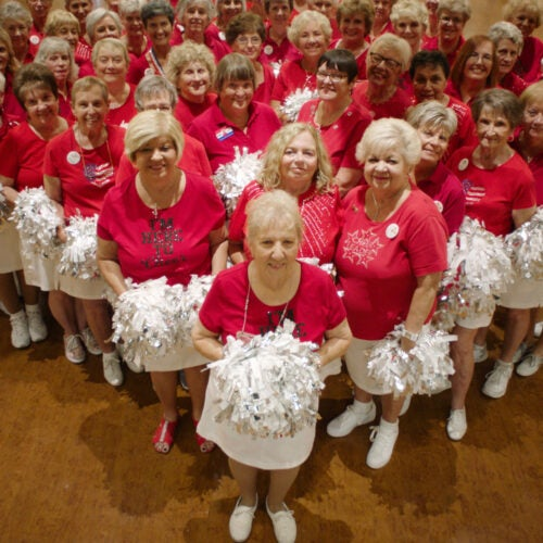 """Group of cheerleaders from retirement community in scene from """"Some Kind of Heaven."""""""