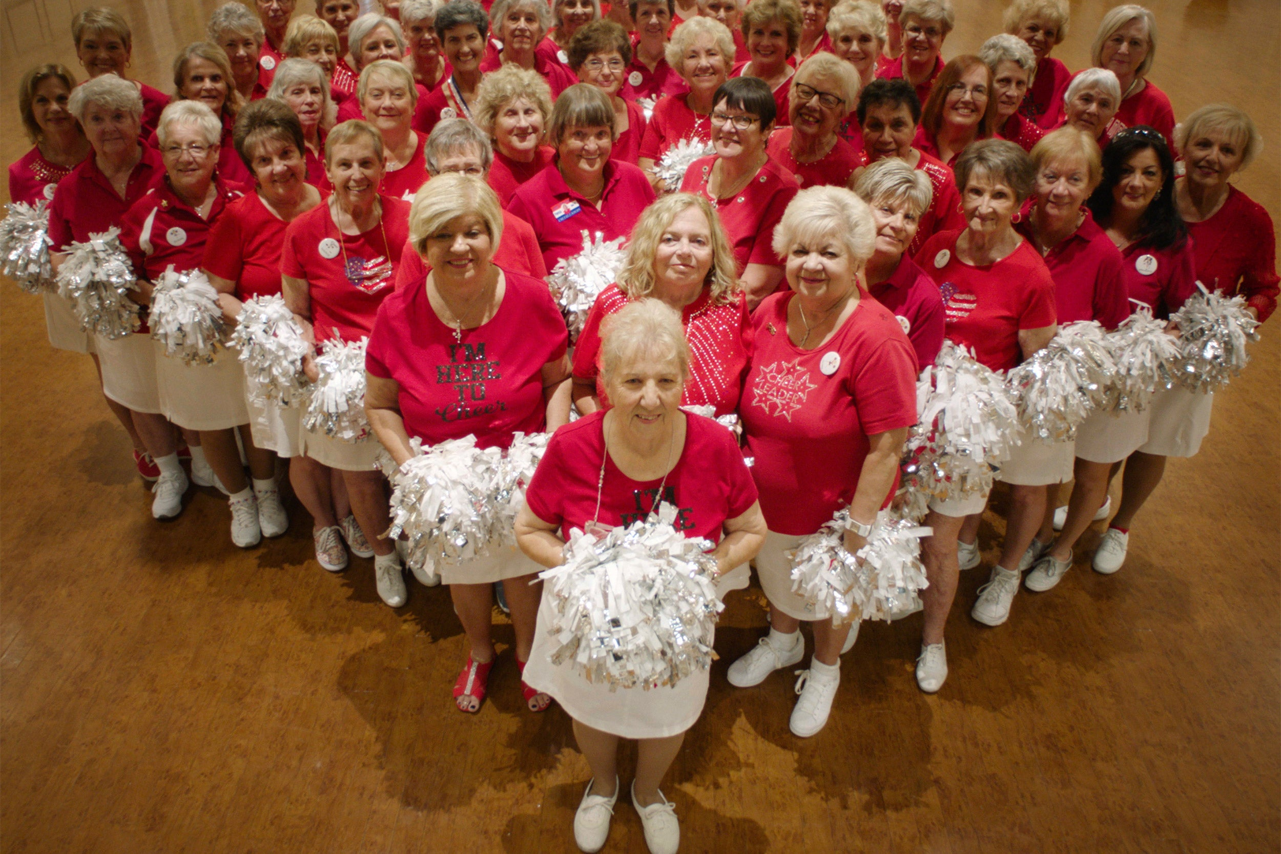 "Group of cheerleaders from retirement community in scene from ""Some Kind of Heaven."""