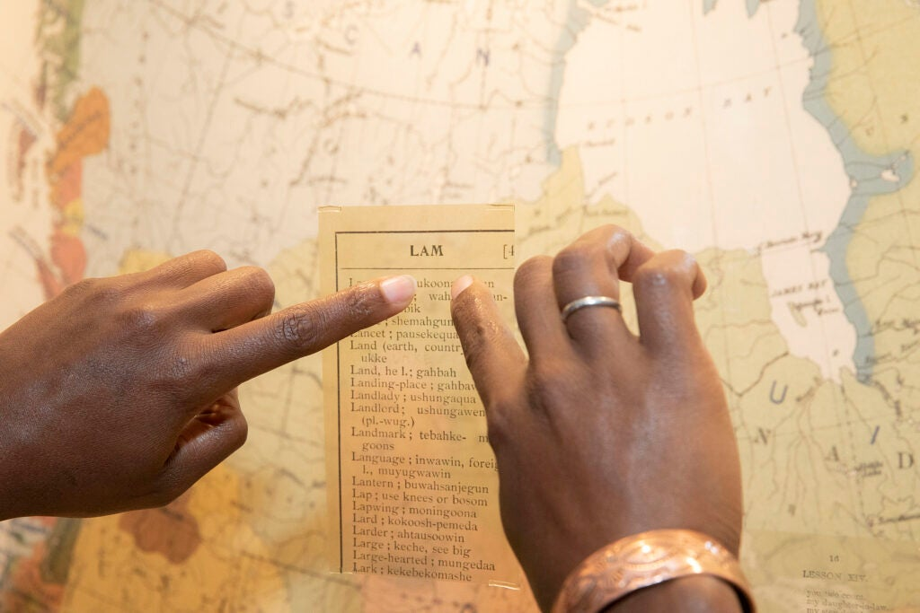 Pointing at a map.