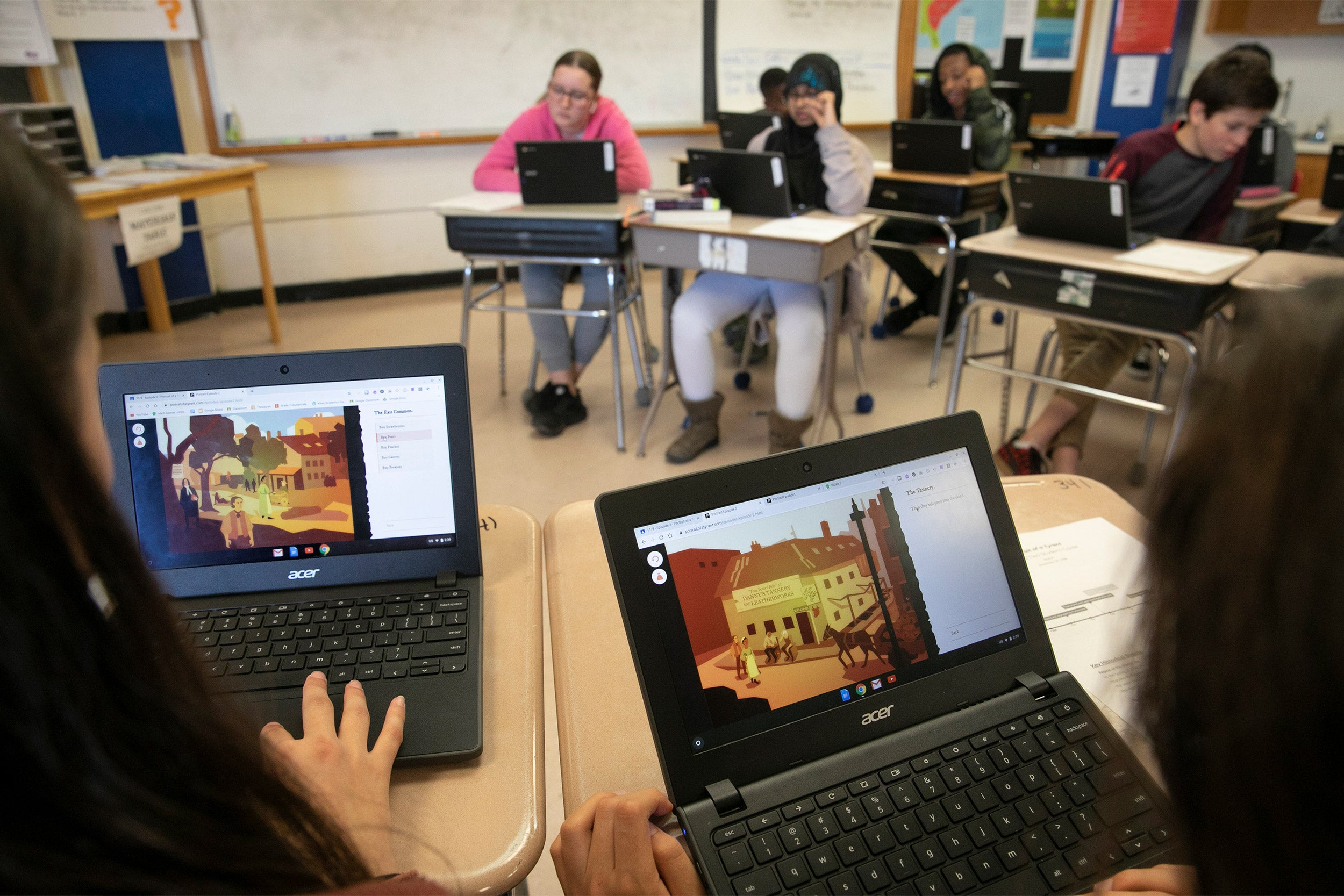 Students in classroom with computers.
