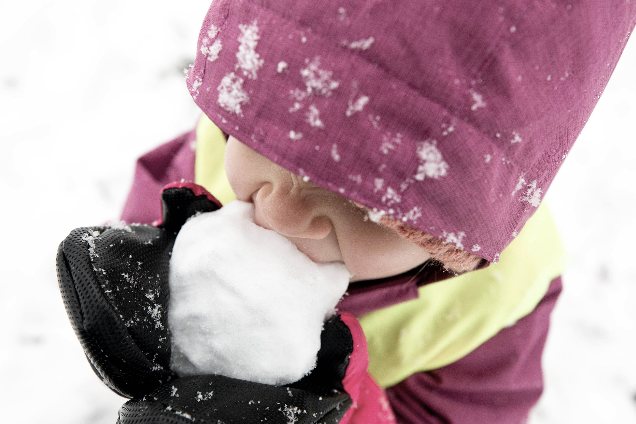A child eats homemade snow cones on Peters Hill.