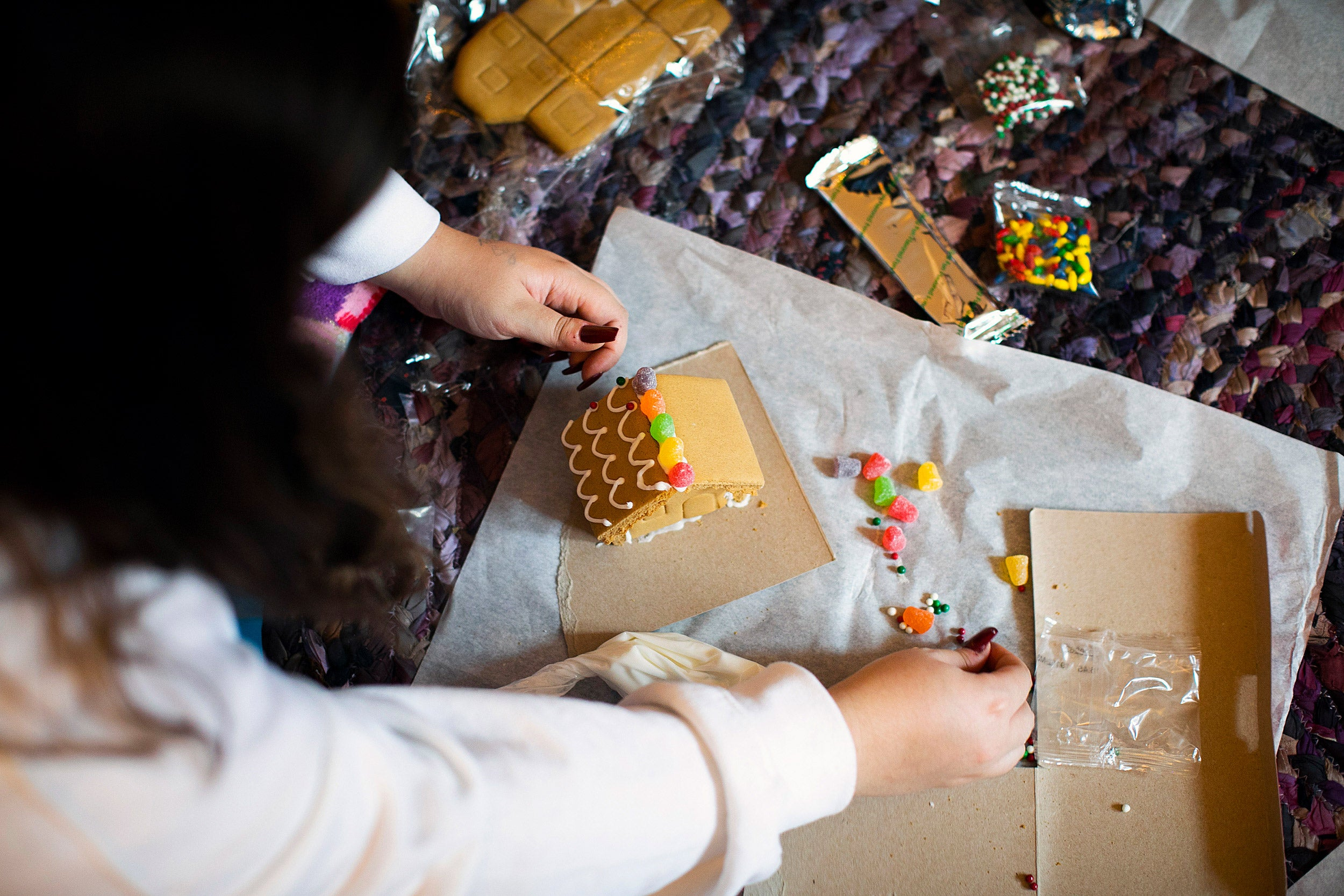 Decorating a gingerbread house.