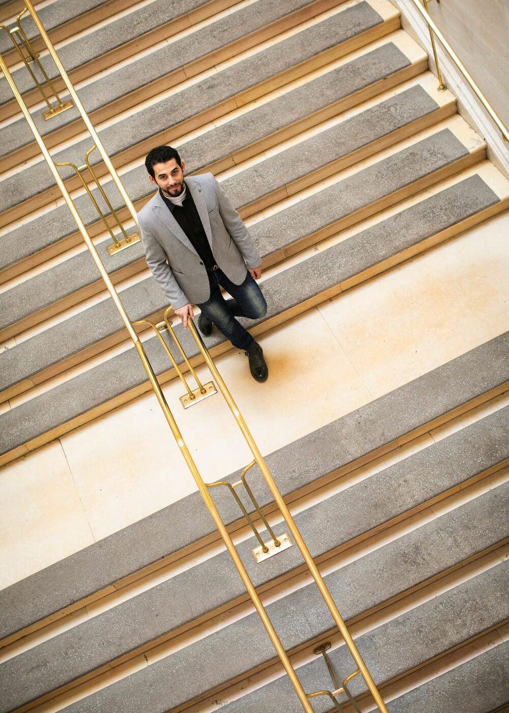 Mosab Abu Toha walking down the stairs.