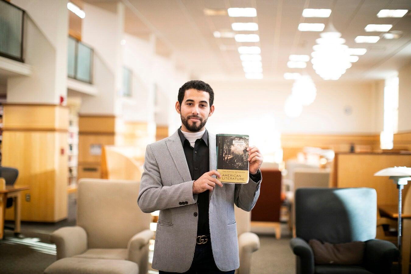 Mosab Abu Toha holding a book.