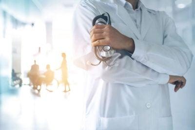 Doctor standing in hallway.