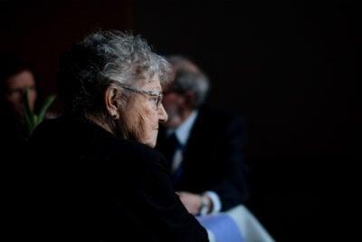 Elderly woman sitting.