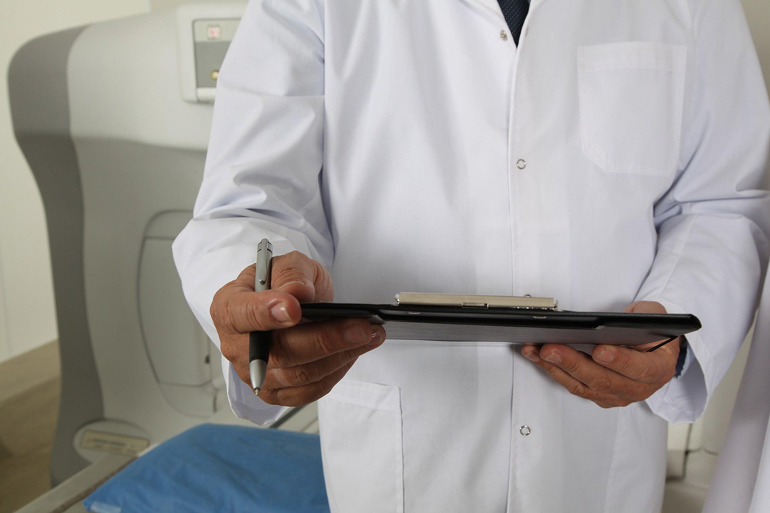 Doctor holding clipboard.