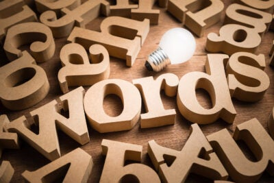 Words alphabets in scattered wood letters on the table.