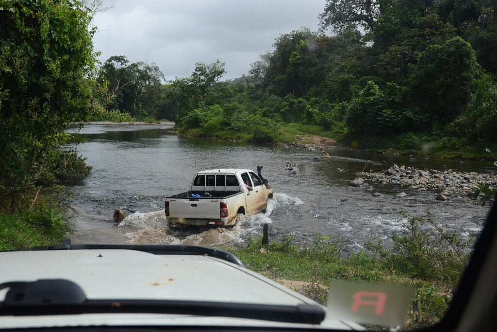 Truck crossing a river.