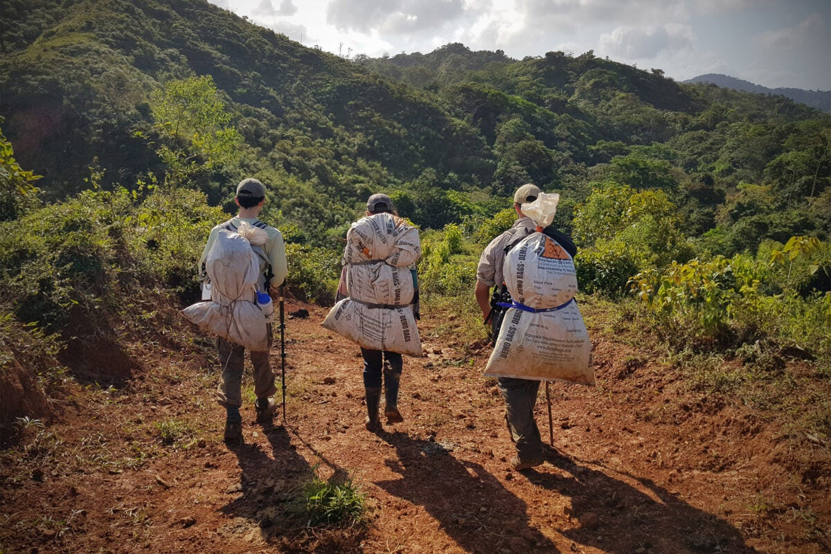 Men walking with collection bags.
