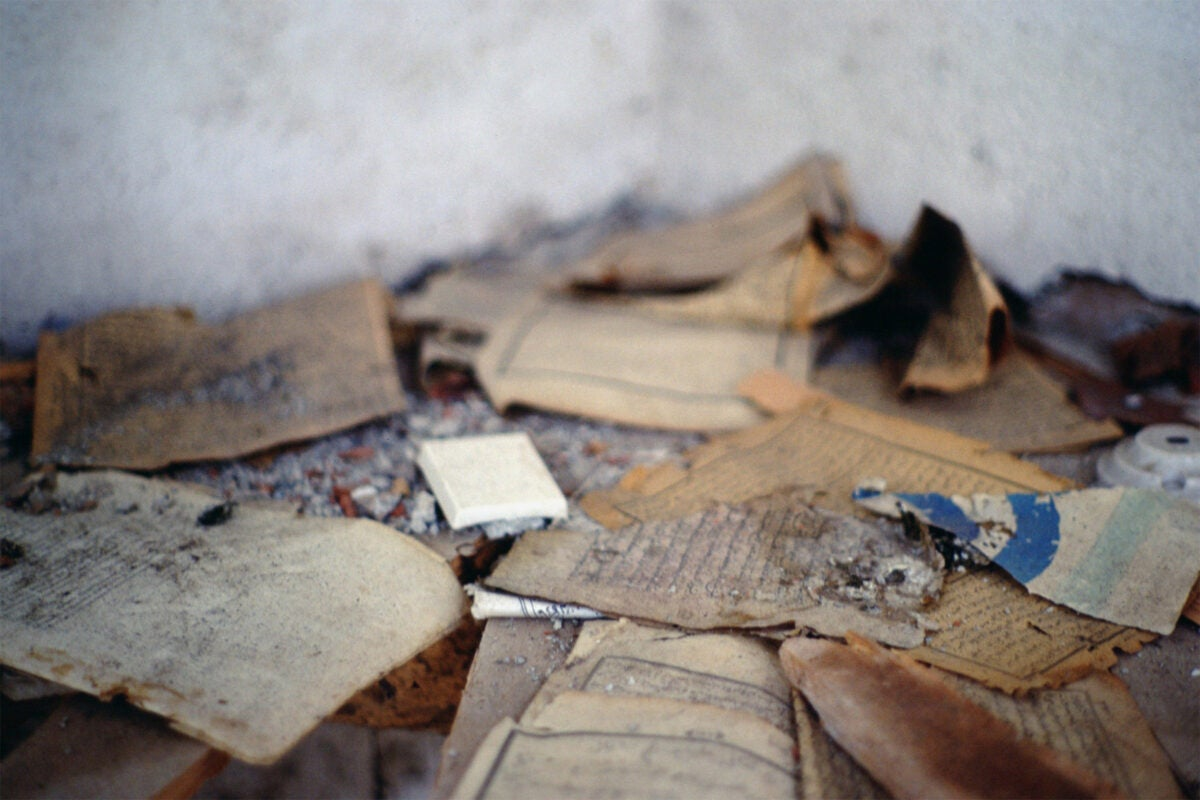 Torn and desecrated religious books and manuscripts.
