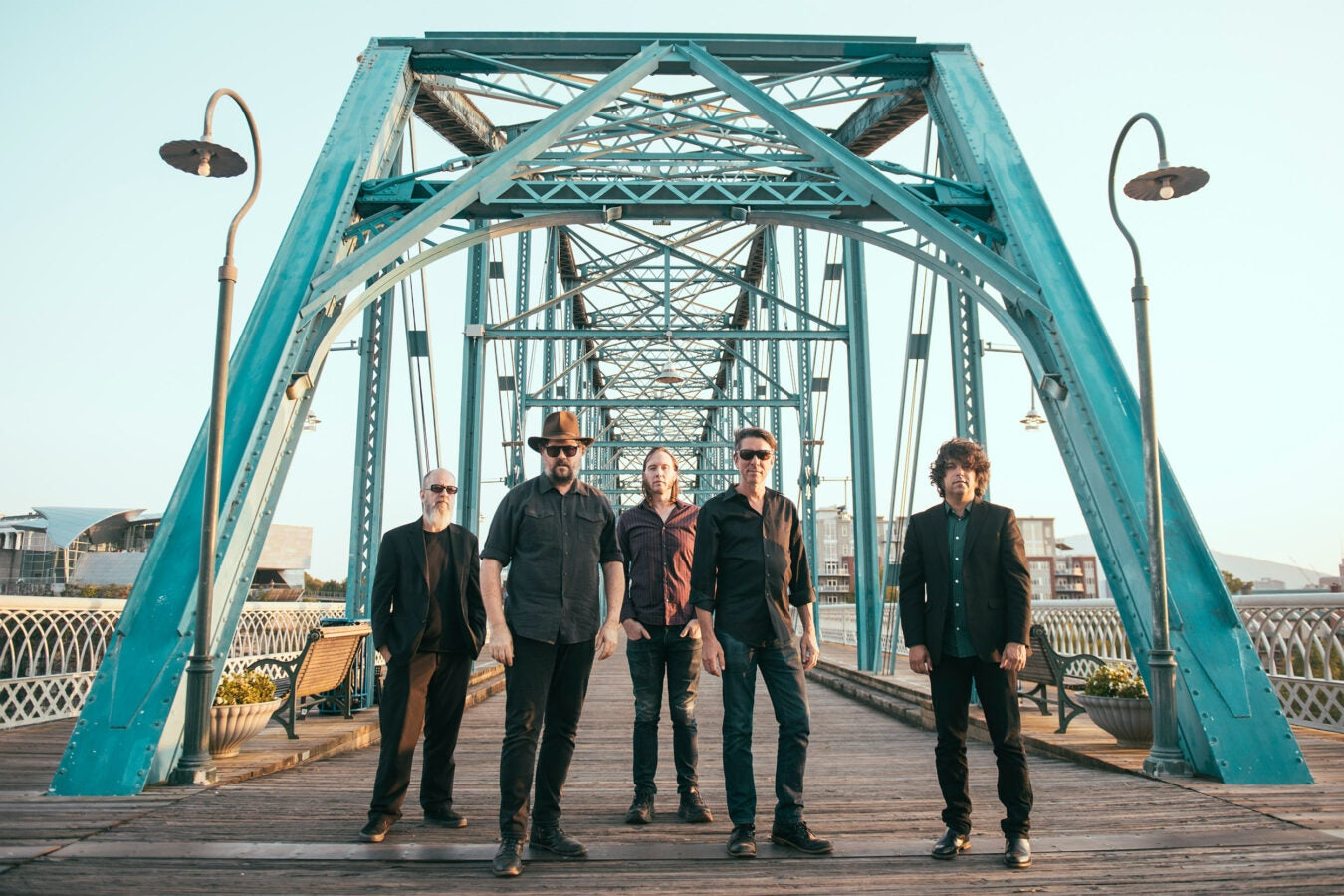 Music group Drive-By Truckers pictured on a bridge.