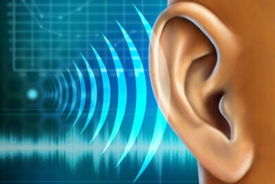 Illustration of an ear getting sound signals.