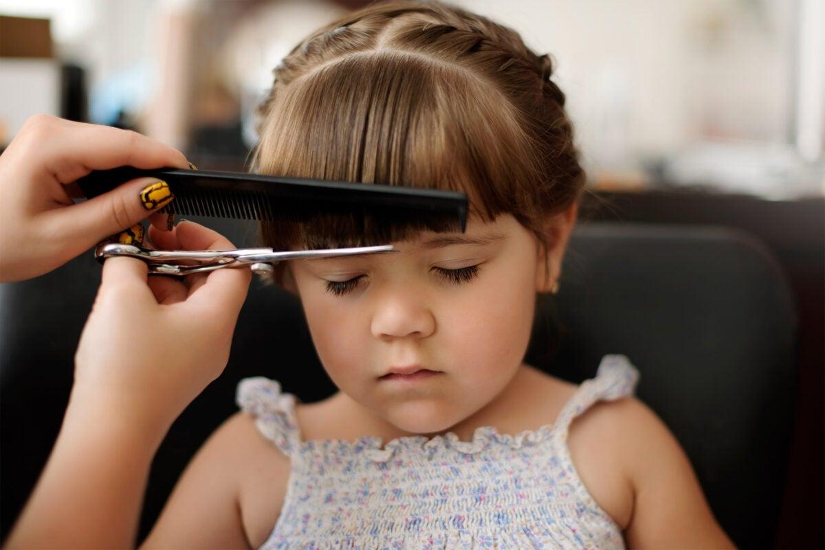 Little girl getting haircut.