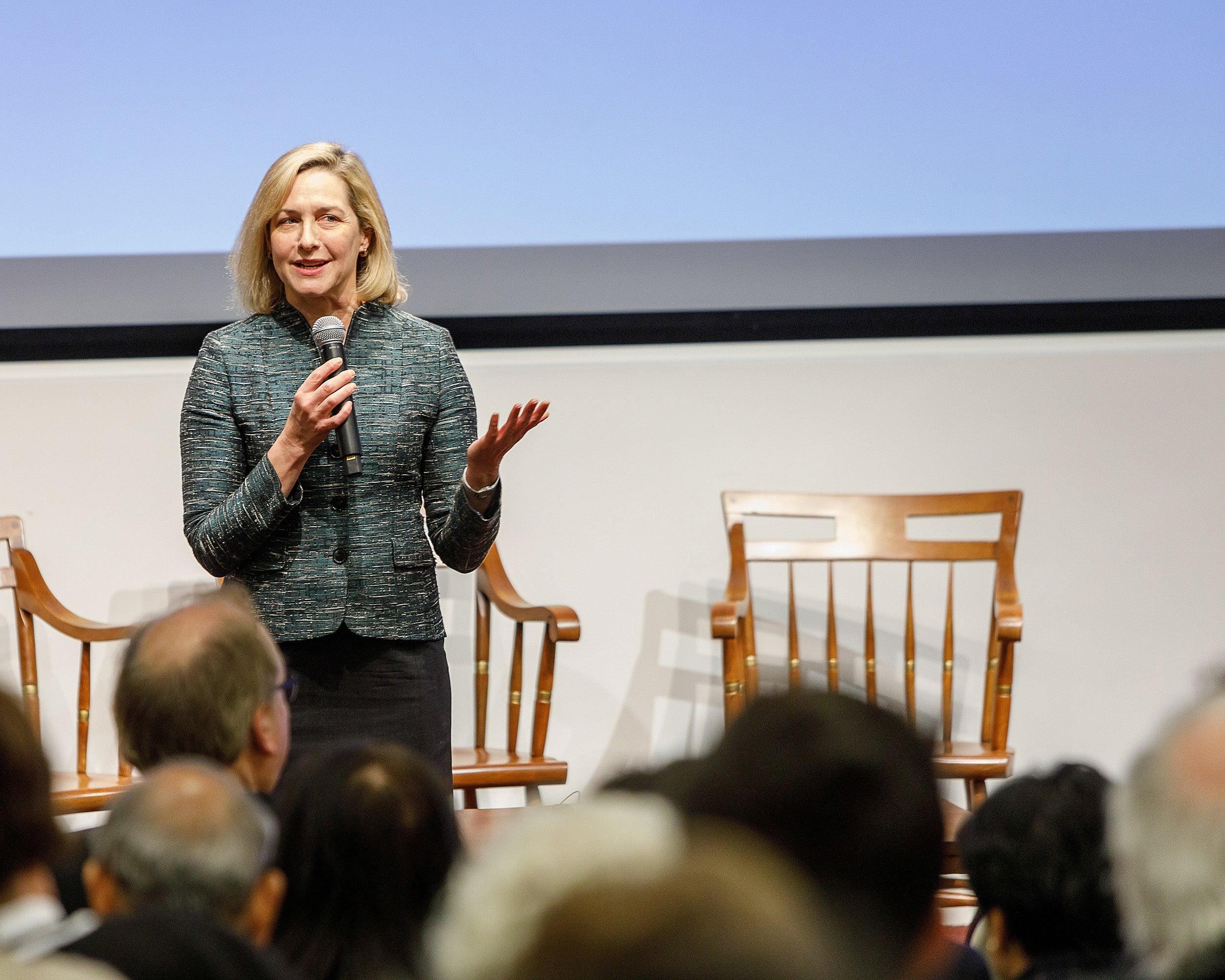 Woman speaking onstage.