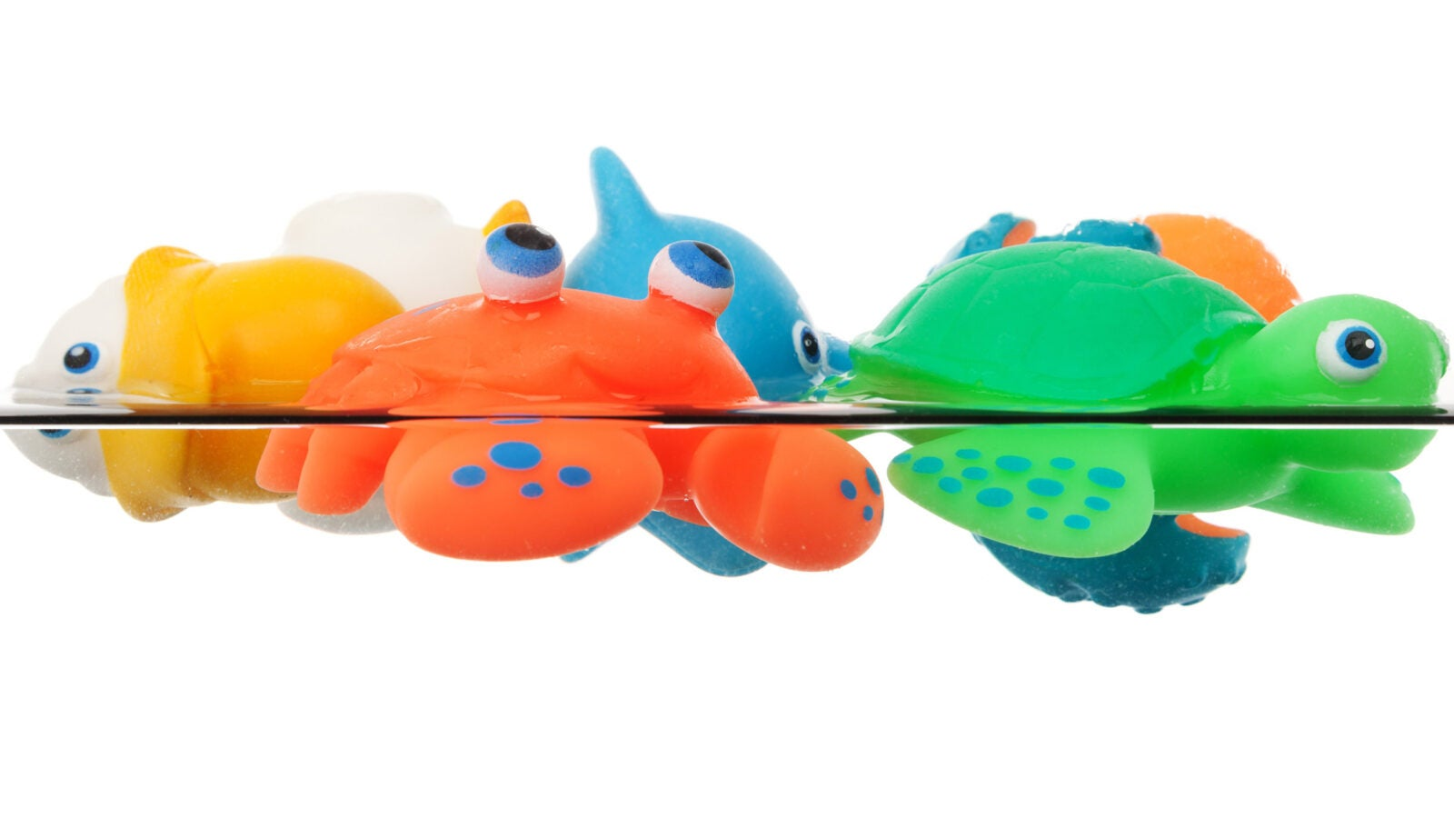 Plastic toys floating on water.