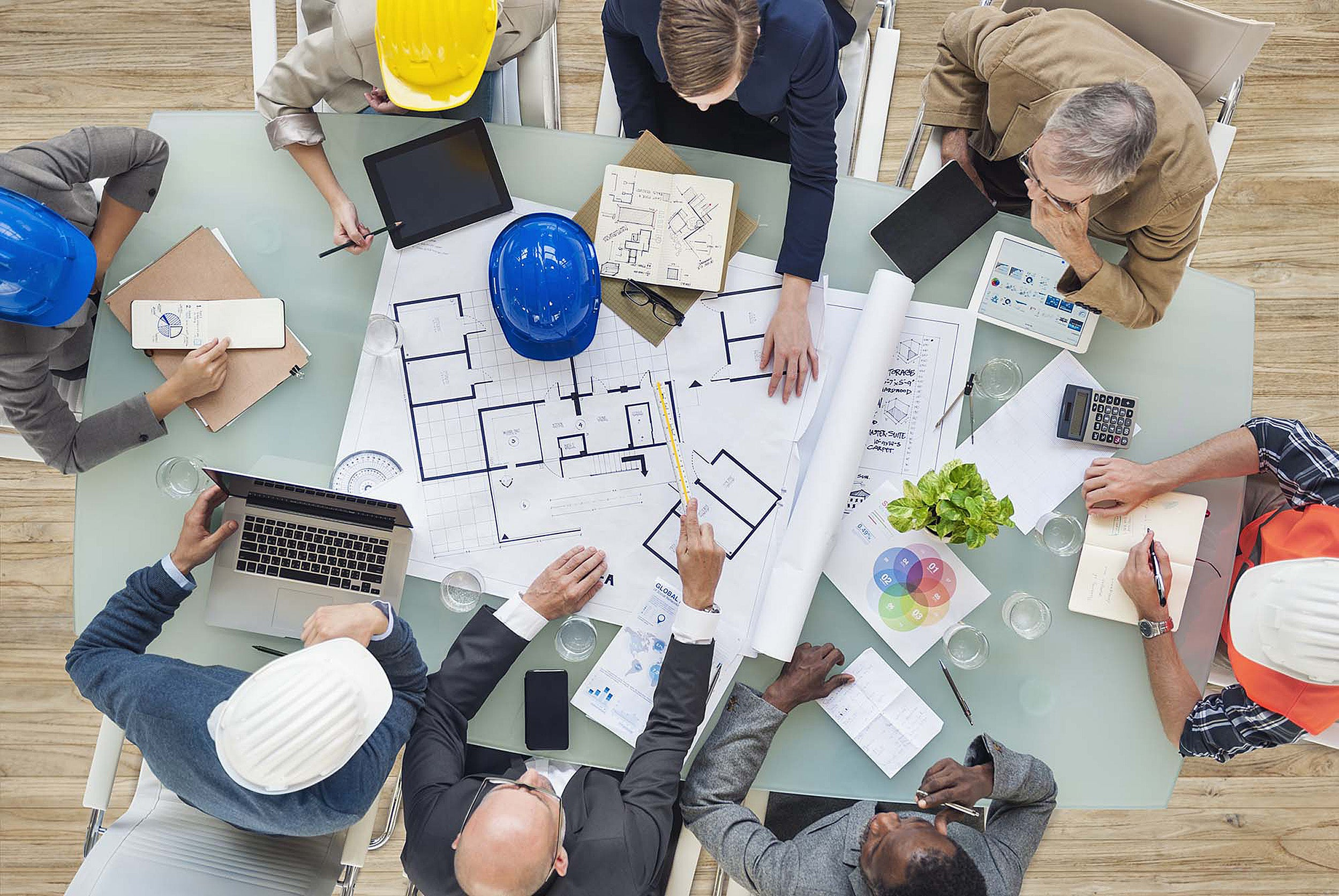 Architects working around a table.