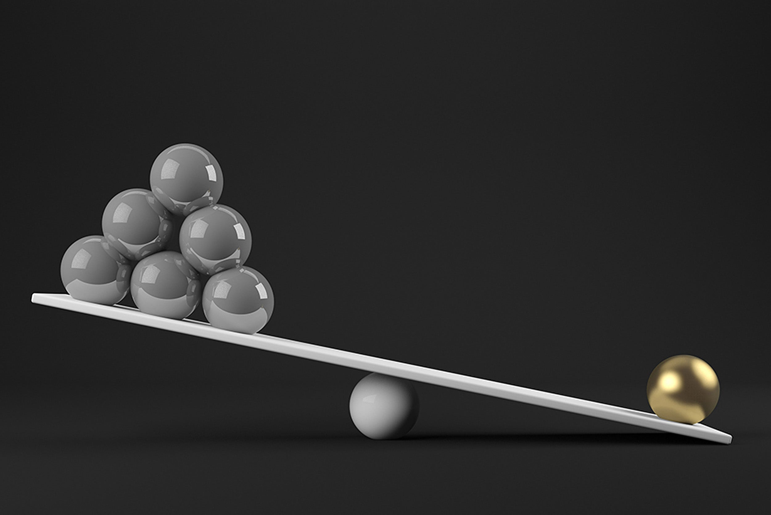 Balls balancing on a scale.