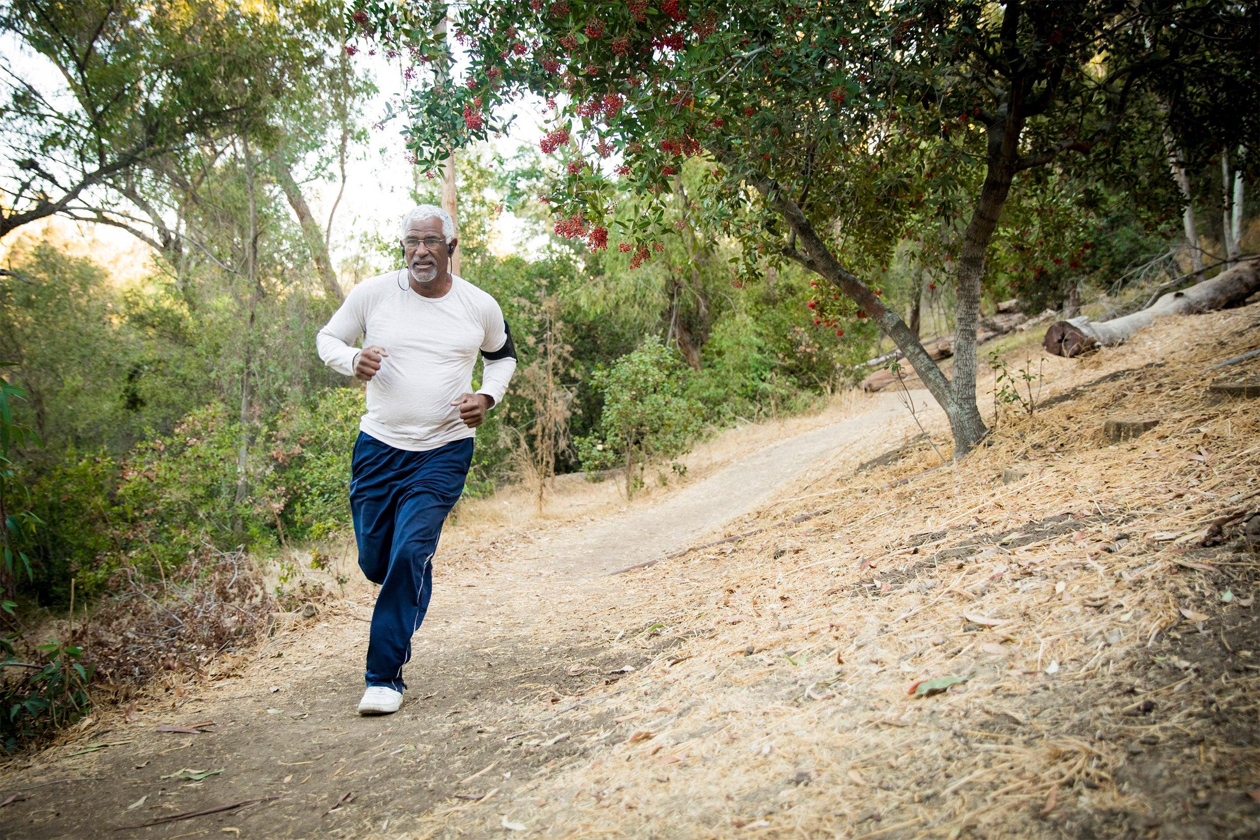 An older man jogging.