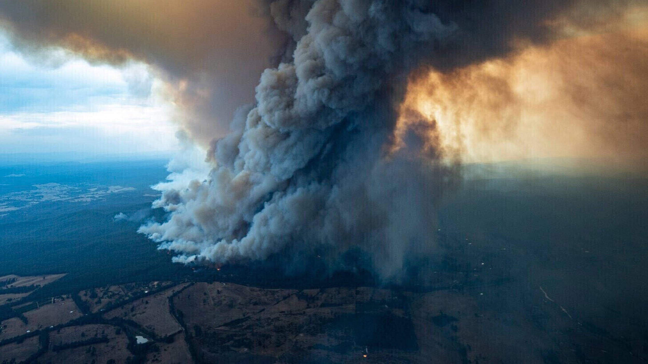 Aerial shot of massive plume of smoke rising from Australia wildfires.