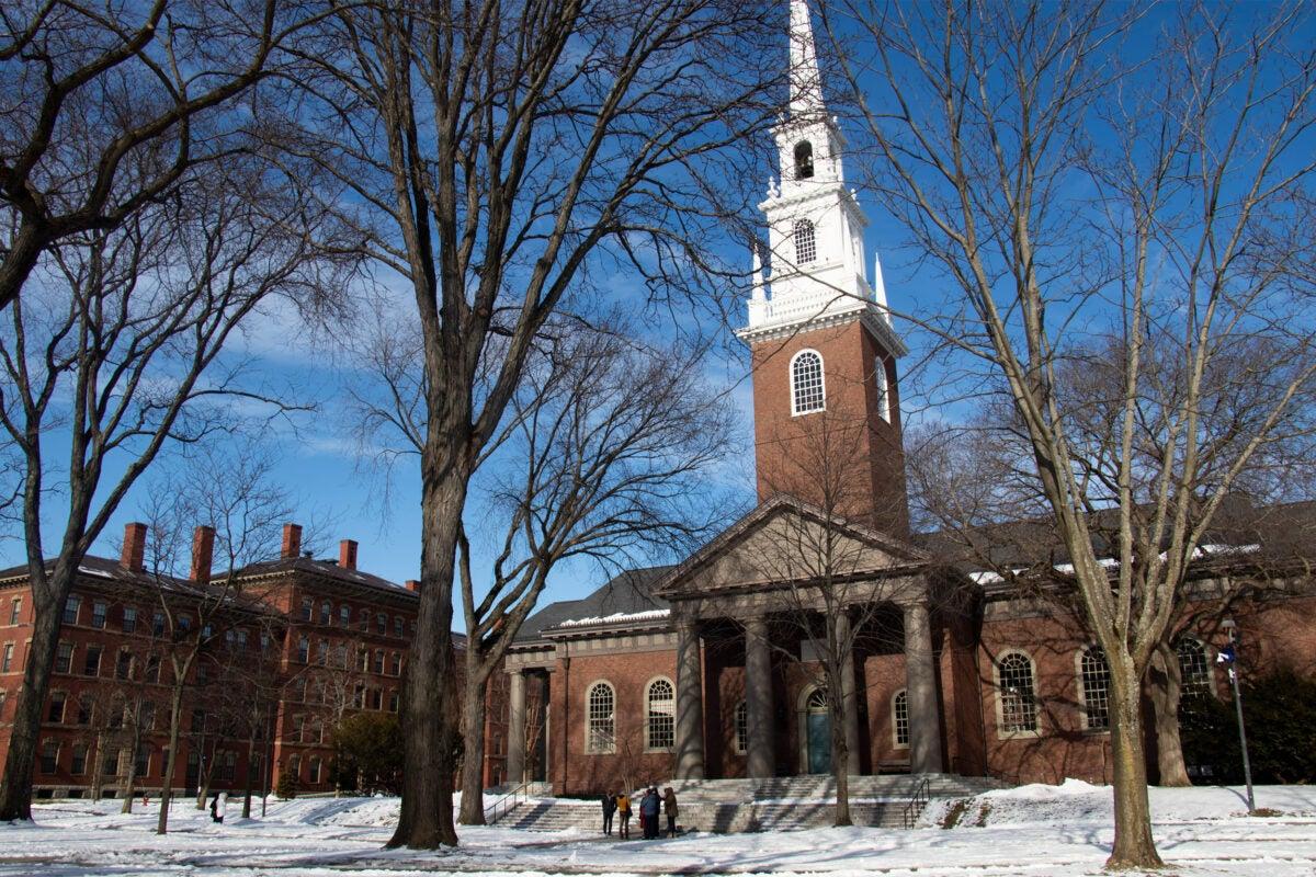Visitors walk through Harvard Yard.