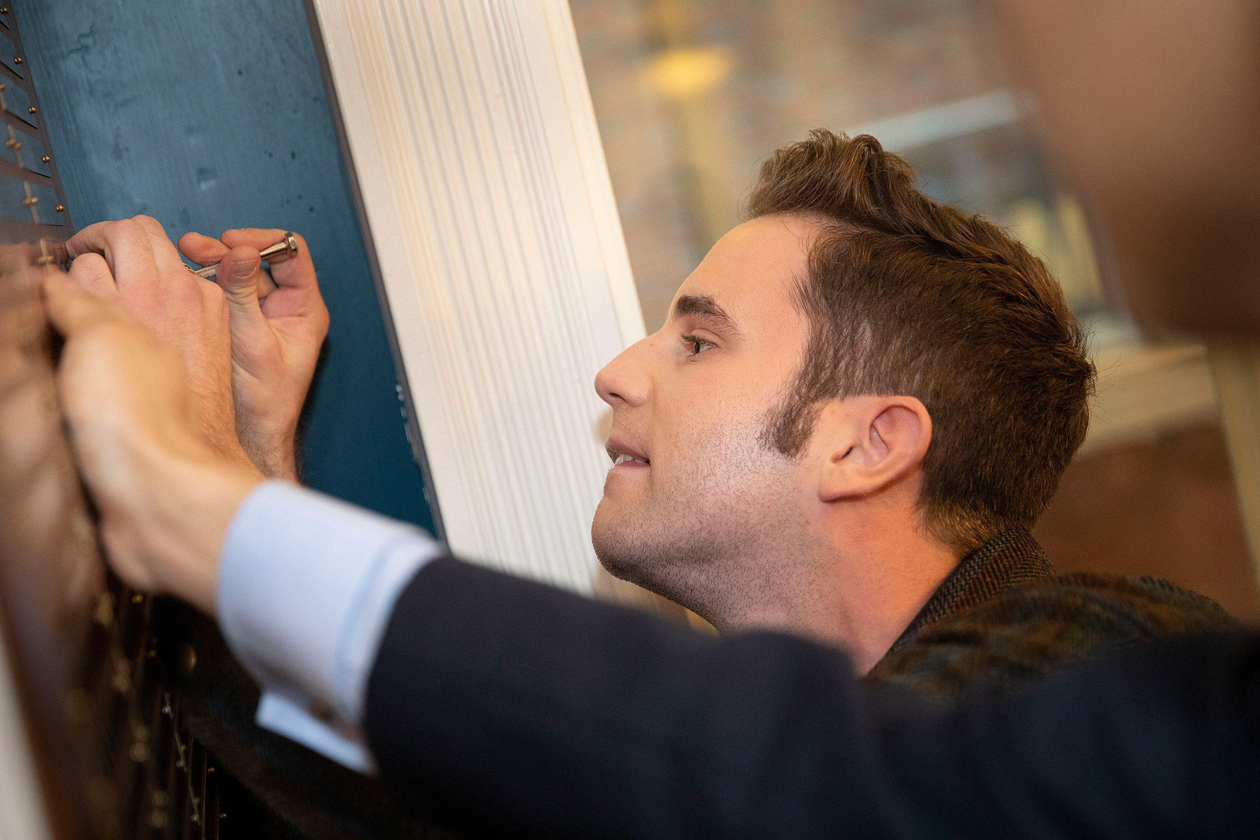 Ben Platt putting his name on the plaque.