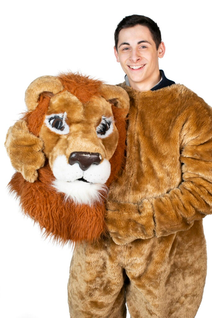 Kyle Mueller is dressed as the Lion Mascot for Winthrop House.
