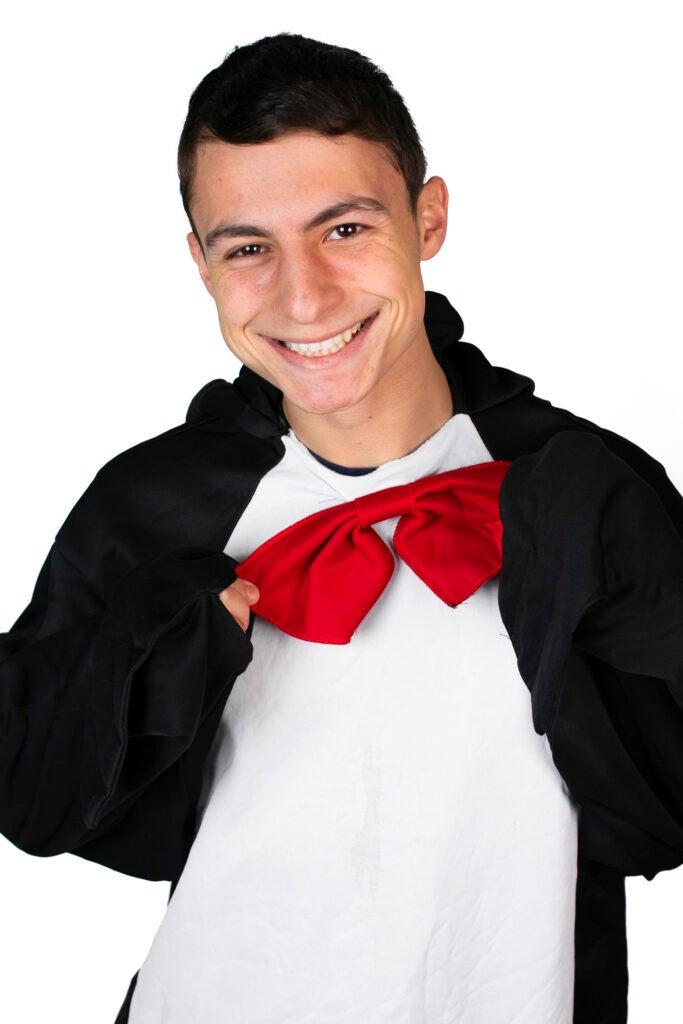 Matthew Miller dresses as the Penguin Mascot for Quincy House.