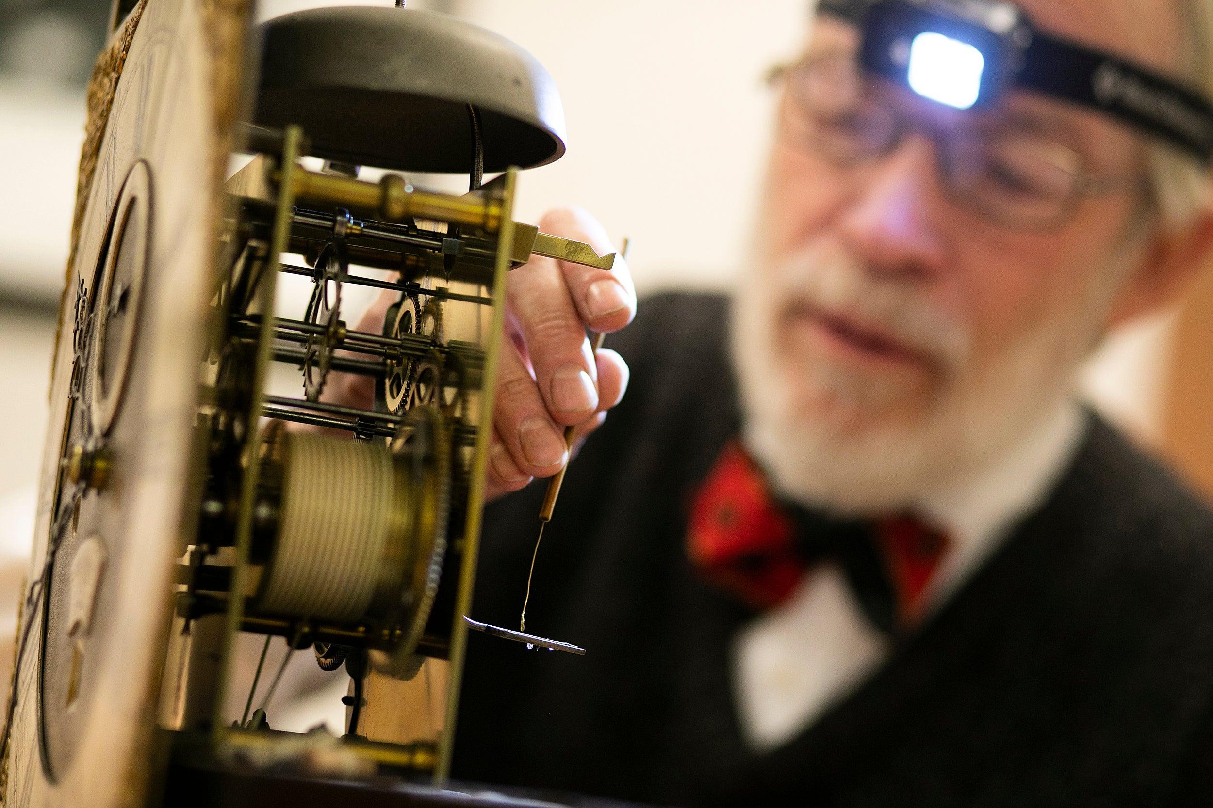 Richard Ketchen working on a clock.