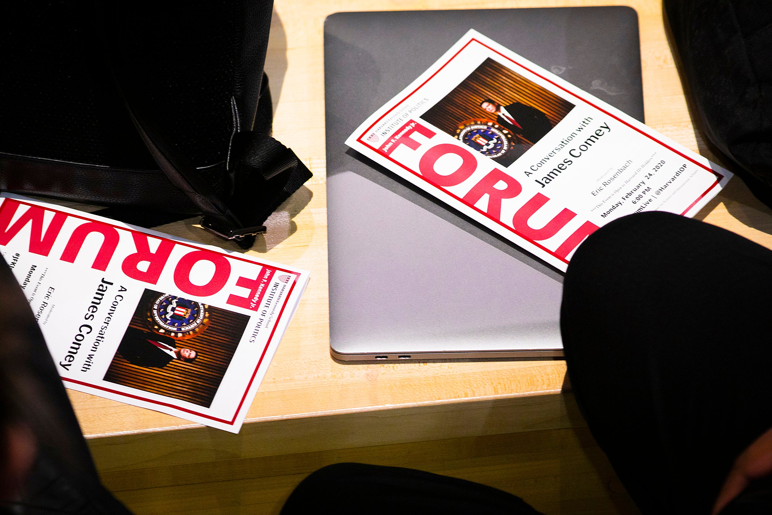 Forum program on table.
