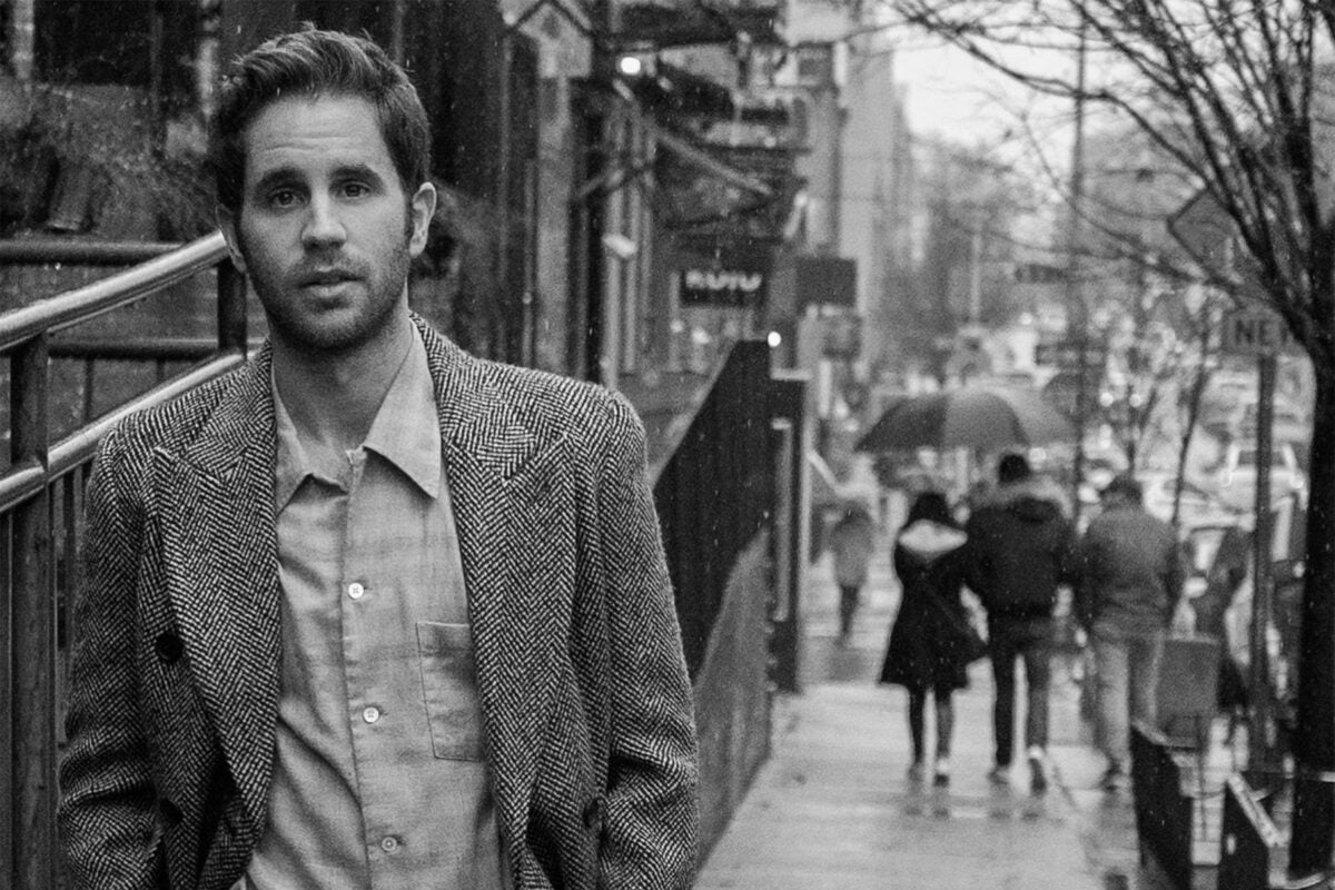 Actor Ben Platt on city street.