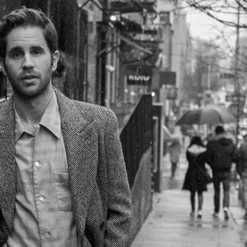 Actor Ben Platt on city street.