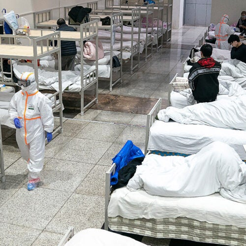 Patients in a makeshift hospital in China.
