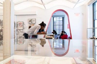 Students view exhibit.