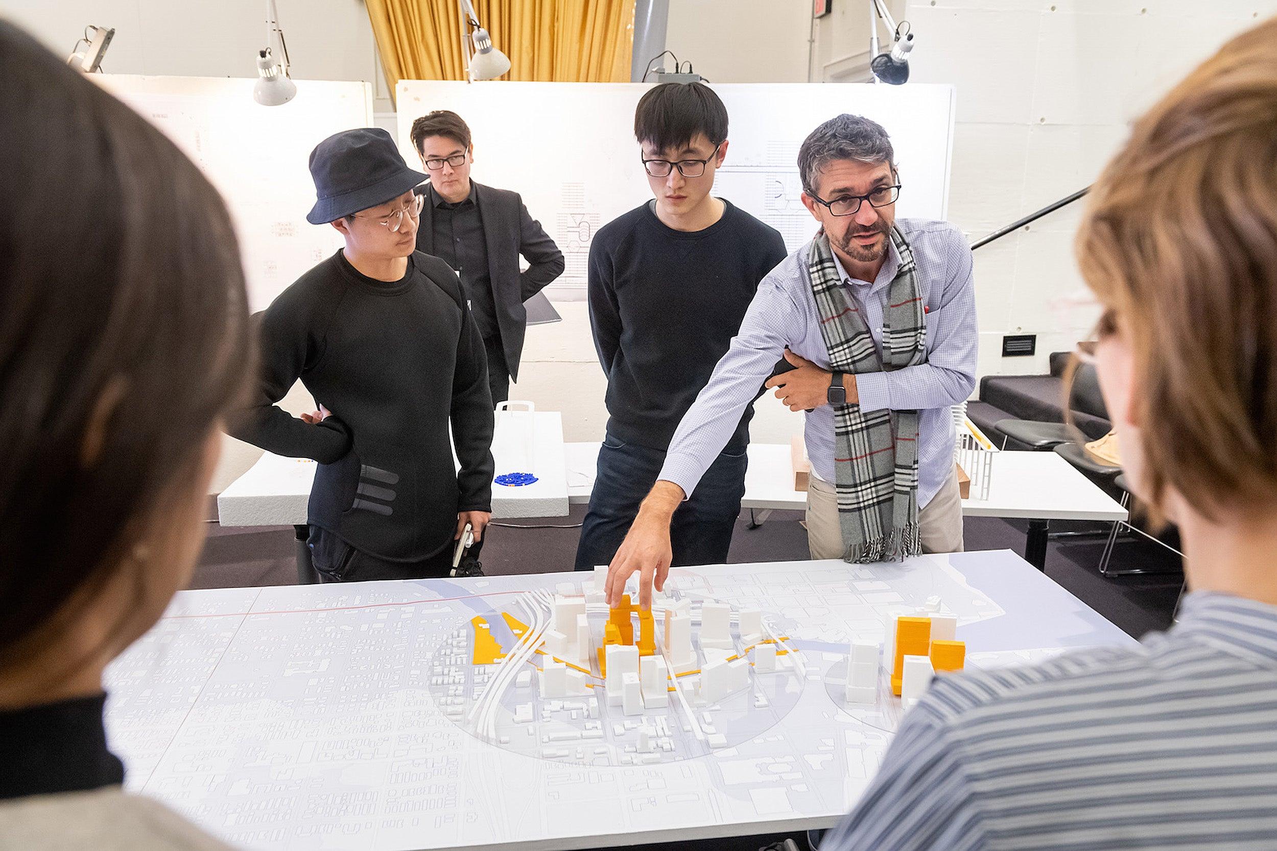Juan Mullerat examines design blueprint.