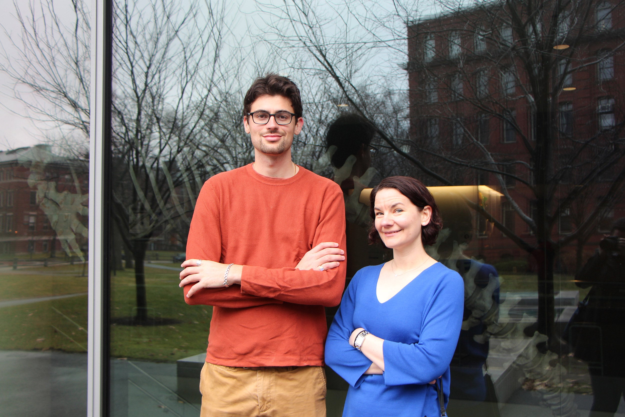 Two researchers standing in front of a building.