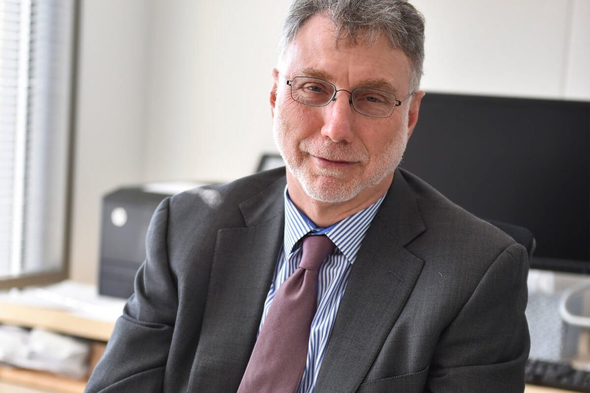 Photo of Marty Baron at his desk.