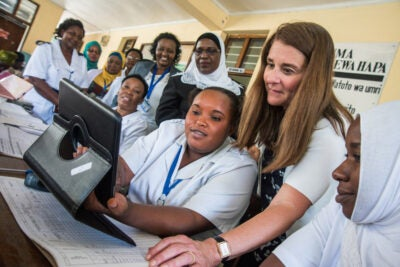 Melinda Gates looking at a computer with nurses in Tanzania.