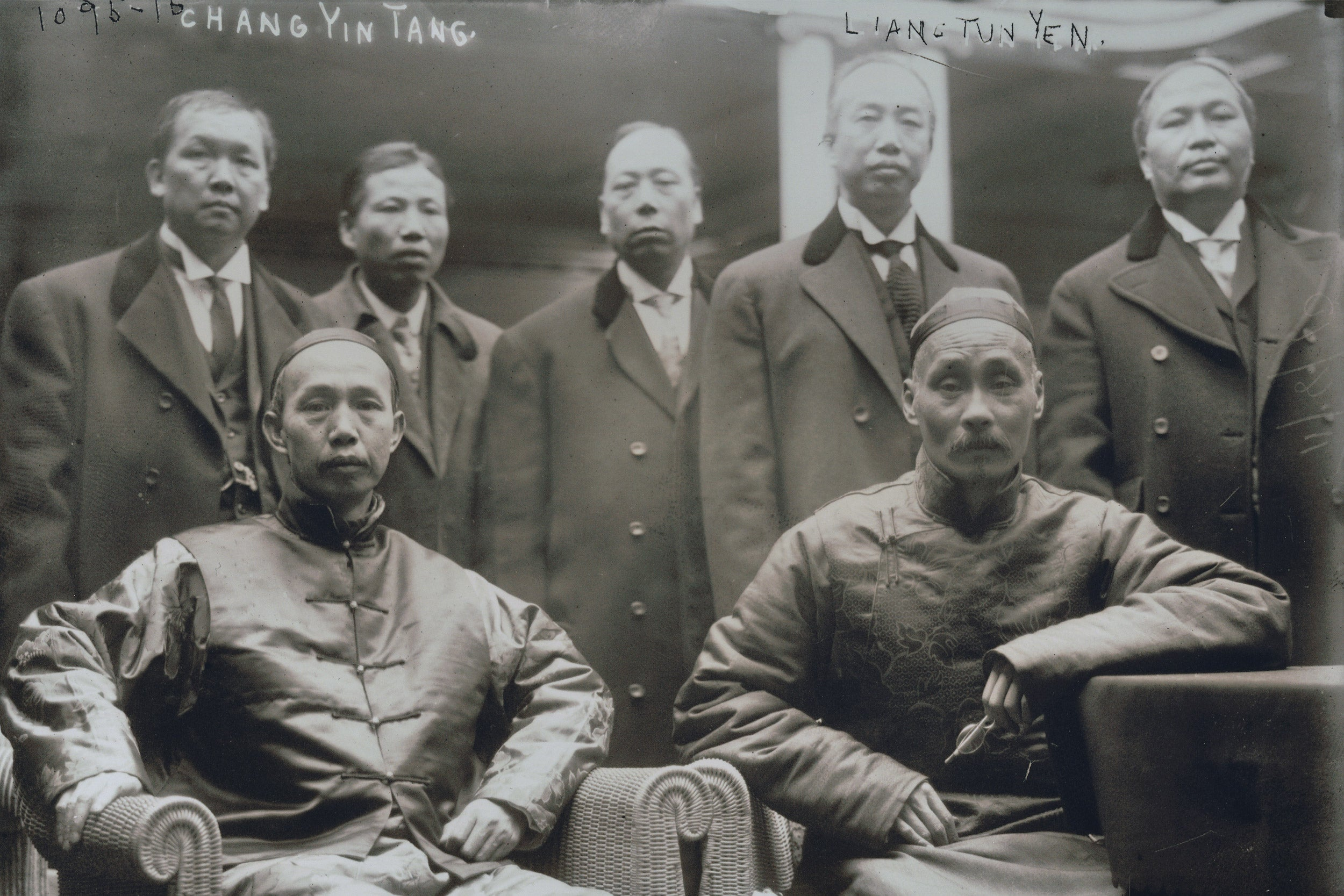 A photo of several Chinese men.