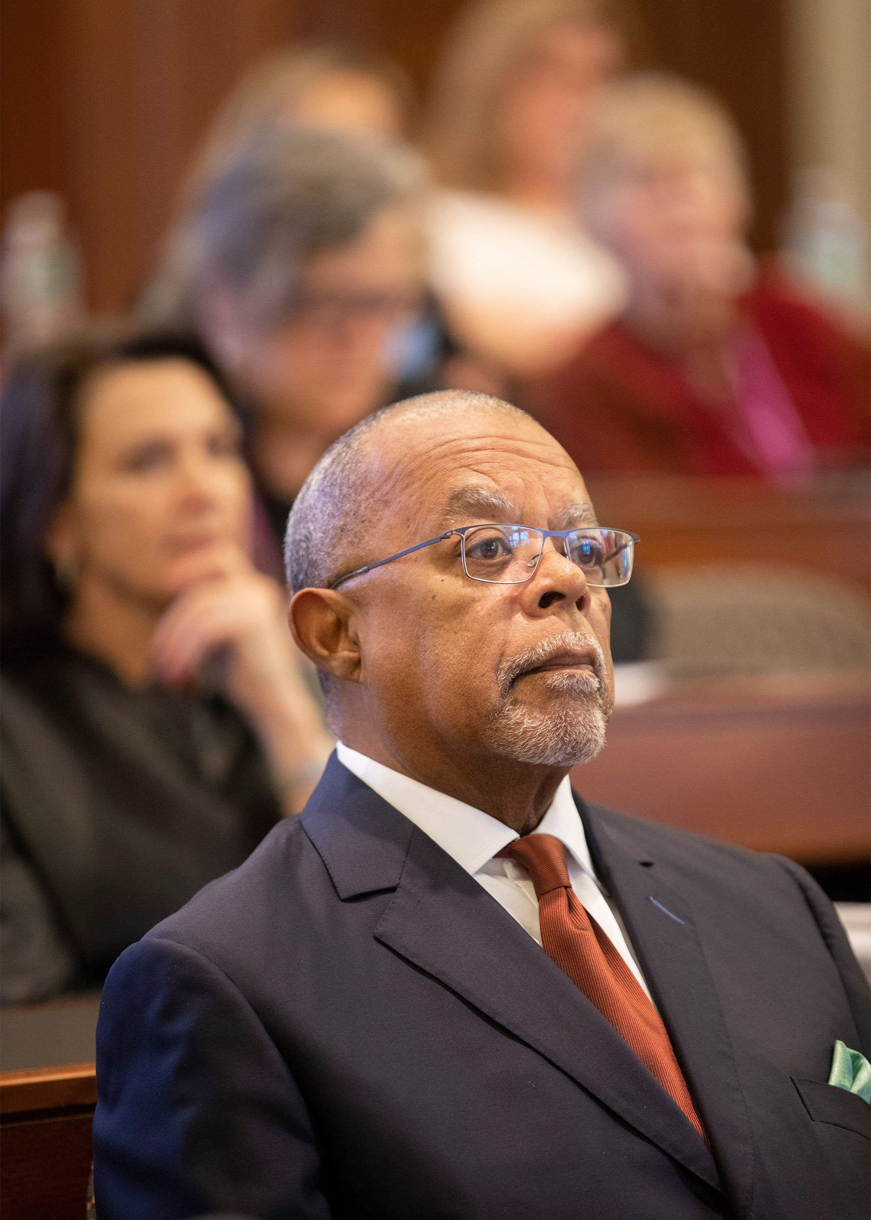Henry Louis Gates Jr. sitting among people in audience.