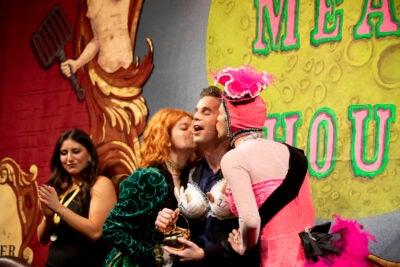 Ben Platt being kissed by Hasty Pudding actors.
