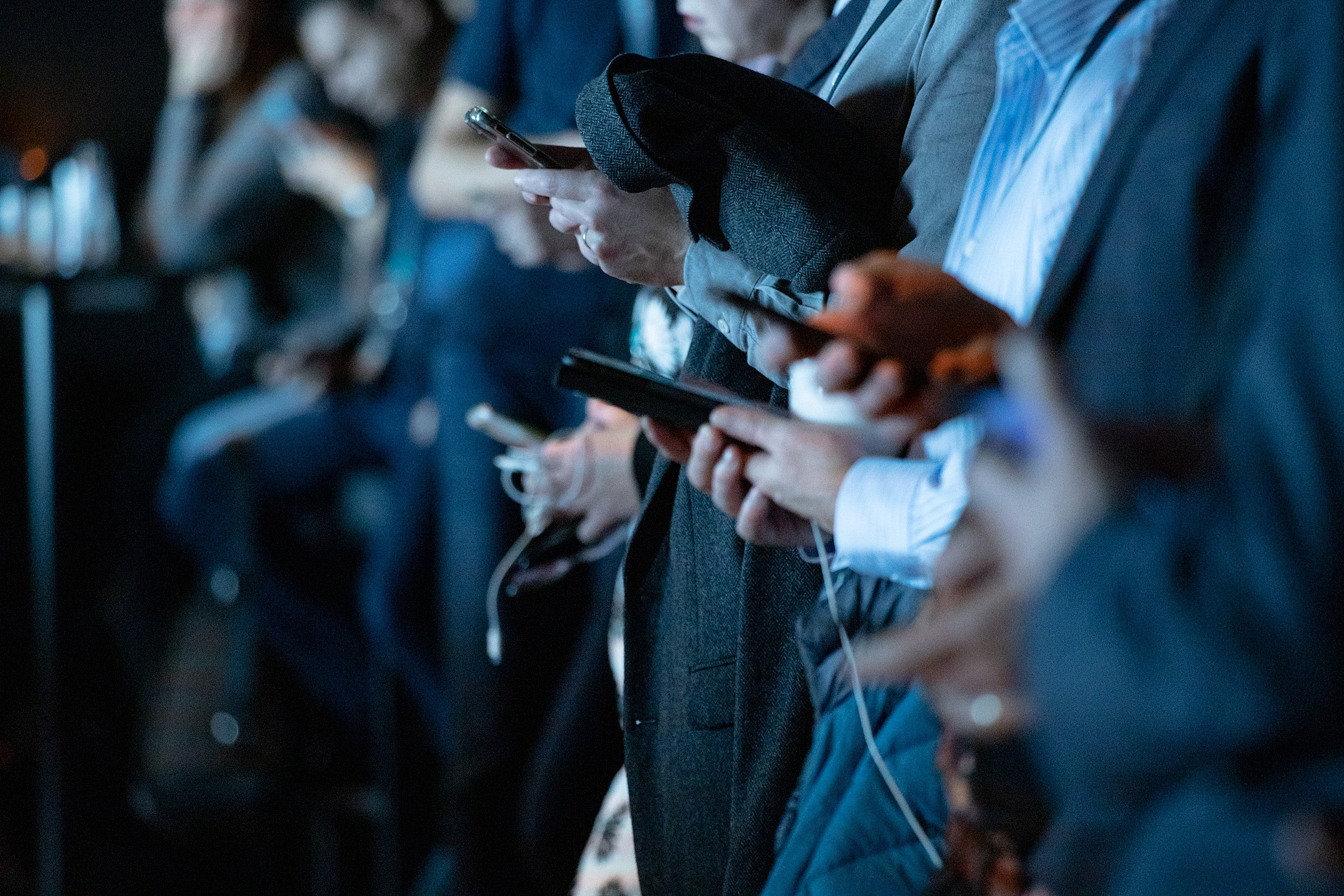 Crowd of people using cellphones.