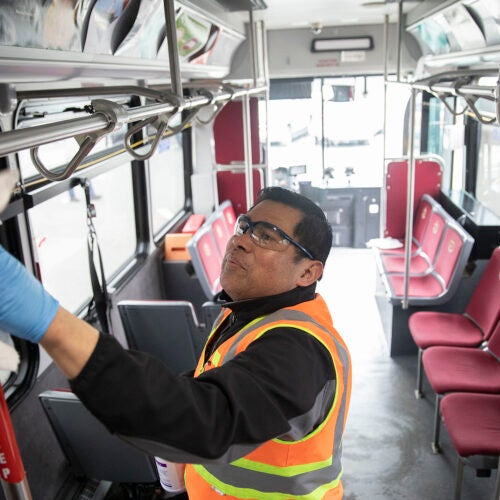 Cleaning a shuttle bus.
